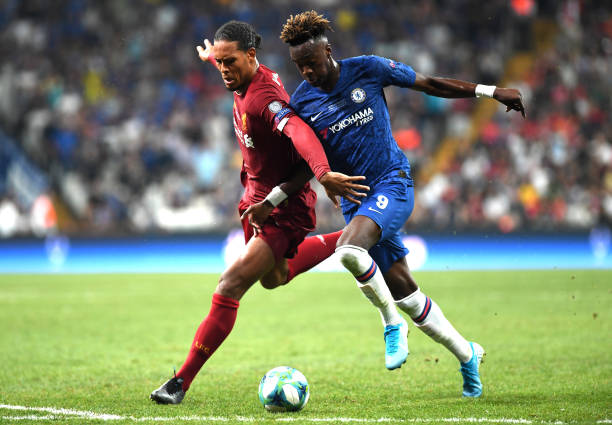 SUPER COUPE EUROPE UEFA 2019 Tammy-abraham-of-chelsea-challenges-for-the-ball-with-virgil-van-dijk-picture-id1168057749?k=6&m=1168057749&s=612x612&w=0&h=ReFQuPNDu5Smph6ZR3x2bN4V6IcQ2fXQShBIS5aEDRo=