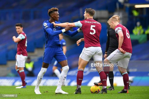 Tammy Abraham of Chelsea clashes with James Tarkowski of Burnley during the Premier League match between Chelsea and Burnley at Stamford Bridge on...