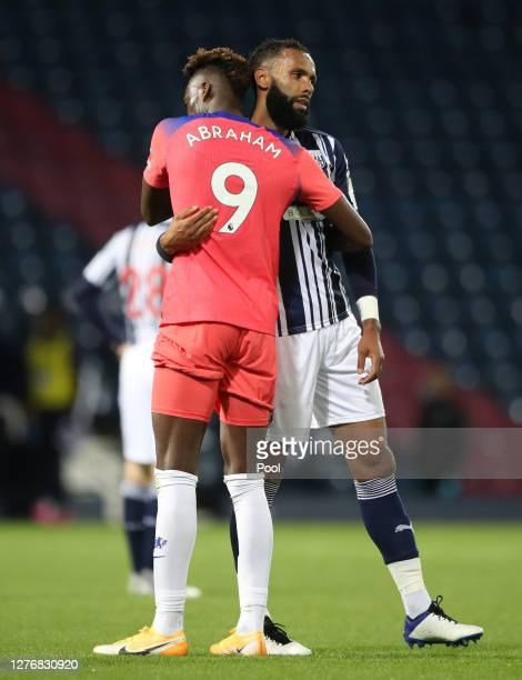 Tammy Abraham of Chelsea embraces Kyle Bartley of West Bromwich Albion following their draw in the Premier League match between West Bromwich Albion...