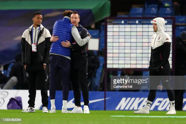 Tammy Abraham of Chelsea interacts with John Terry, assistant manager of Aston Villa ahead of the Premier League match between Chelsea and Aston...