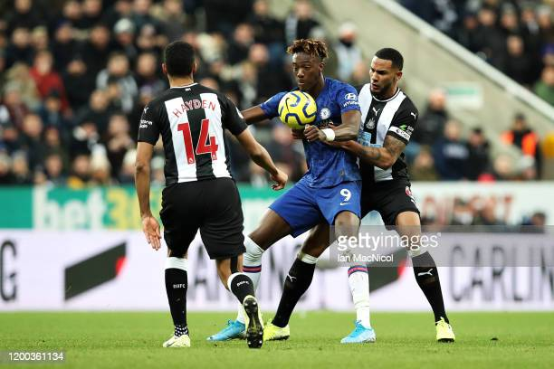 Tammy Abraham of Chelsea is challenged by Jamaal Lascelles of Newcastle United during the Premier League match between Newcastle United and Chelsea...