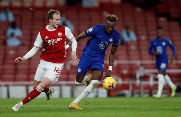 Tammy Abraham of Chelsea is challenged by Rob Holding of Arsenal during the Premier League match between Arsenal and Chelsea at Emirates Stadium on...