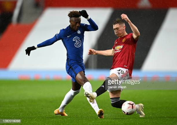 Tammy Abraham of Chelsea is challenged by Scott McTominay of Manchester United during the Premier League match between Manchester United and Chelsea...