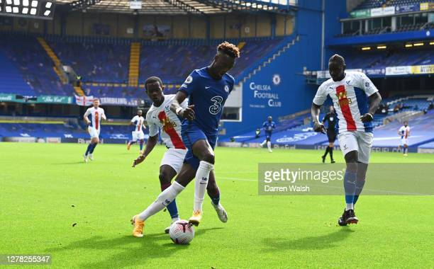 Tammy Abraham of Chelsea is challenged by Tyrick Mitchell of Crystal Palace during the Premier League match between Chelsea and Crystal Palace at...