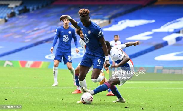 Tammy Abraham of Chelsea is fouled by Tyrick Mitchell of Crystal Palace leading to a penalty during the Premier League match between Chelsea and...