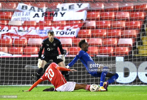 Tammy Abraham of Chelsea is tackled inside the Barnsley area by Toby Sibbick of Barnsley during The Emirates FA Cup Fifth Round match between...