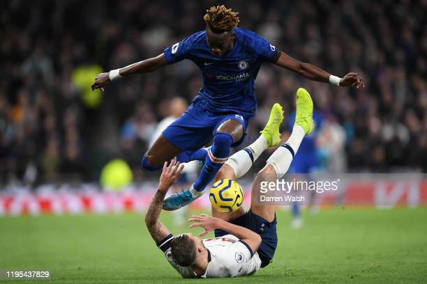 Tammy Abraham of Chelsea jumps over Toby Alderweireld of Tottenham Hotspur during the Premier League match between Tottenham Hotspur and Chelsea FC...