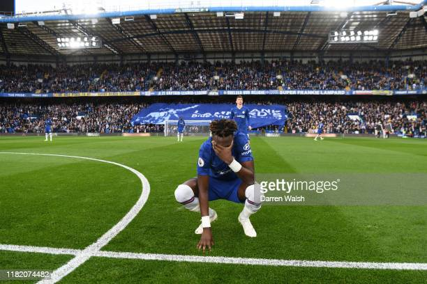 Tammy Abraham of Chelsea kneels on the pitch during the Premier League match between Chelsea FC and Newcastle United at Stamford Bridge on October 19...