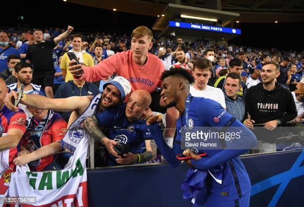 Tammy Abraham of Chelsea poses for a selfie with Chelsea fans following victory in the UEFA Champions League Final between Manchester City and...