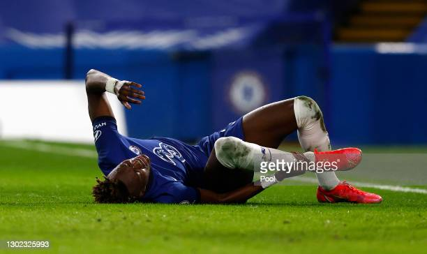 Tammy Abraham of Chelsea reacts after a collision leading to him going off injured during the Premier League match between Chelsea and Newcastle...