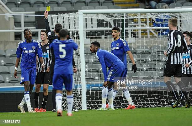 Tammy Abraham of Chelsea receives a yellow card from referee David Coote after a handball during the FA Youth Cup Sixth Round match between Newcastle...