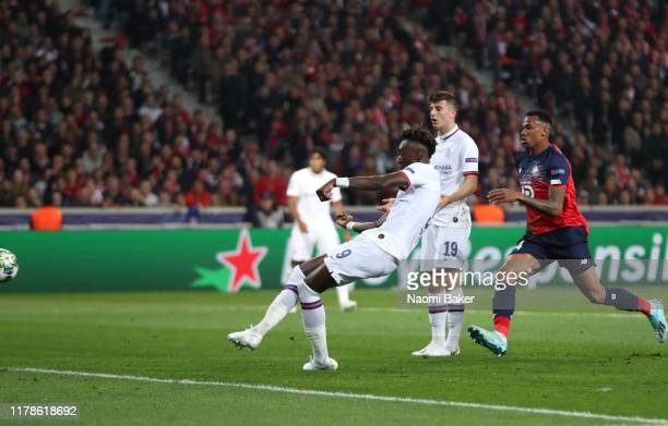 Tammy Abraham of Chelsea scores his sides first goal during the UEFA Champions League group H match between Lille OSC and Chelsea FC at Stade Pierre...