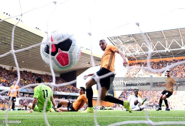 Tammy Abraham of Chelsea scores his team's third goal past Rui Patricio of Wolverhampton Wanderers during the Premier League match between...