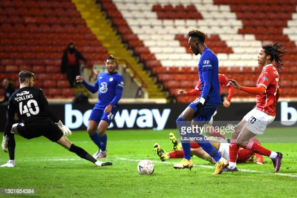 Tammy Abraham of Chelsea scores their sides first goal during The Emirates FA Cup Fifth Round match between Barnsley and Chelsea at Oakwell Stadium...