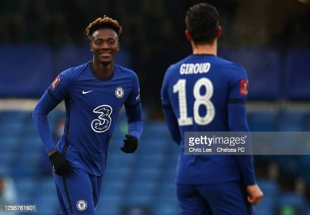 Tammy Abraham of Chelsea smiles at Olivier Giroud of Chelsea during the FA Cup Third Round match between Chelsea and Morecambe at Stamford Bridge on...