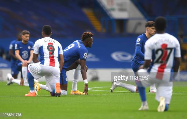 Tammy Abraham of Chelsea takes a knee in support of the black lives matter movement prior to the Premier League match between Chelsea and Crystal...