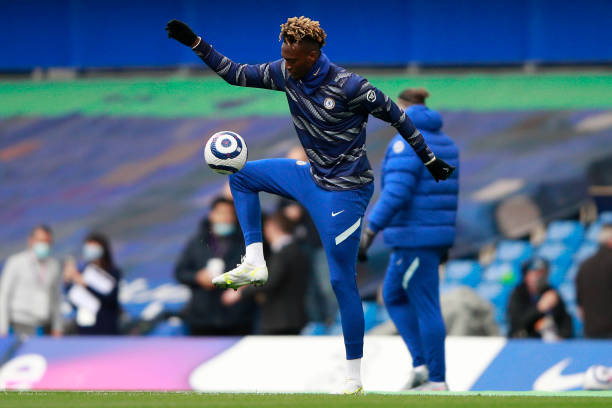 Tammy Abraham of Chelsea warms up prior to the Premier League match between Chelsea and Fulham at Stamford Bridge on May 01, 2021 in London, England....