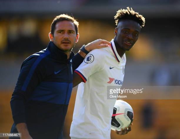 Tammy Abraham of Chelsea with the match ball and his manager Frank Lampard after his hatrick following the the Premier League match between...
