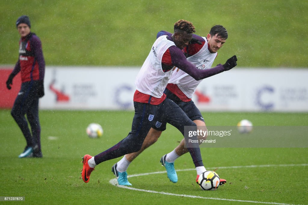 Tammy Abraham of England and Harry Maguire of England battle for posession during an England training session at St Georges Park on November 7, 2017 in Burton-upon-Trent, England.