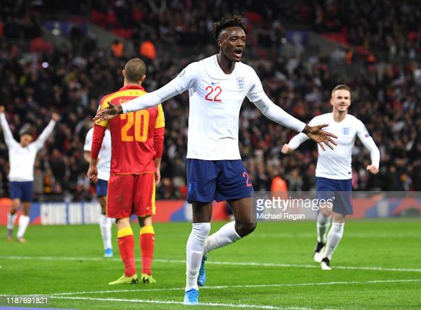 Tammy Abraham of England celebrates after scoring his sides seventh goal with Jadon Sancho during the UEFA Euro 2020 qualifier between England and...