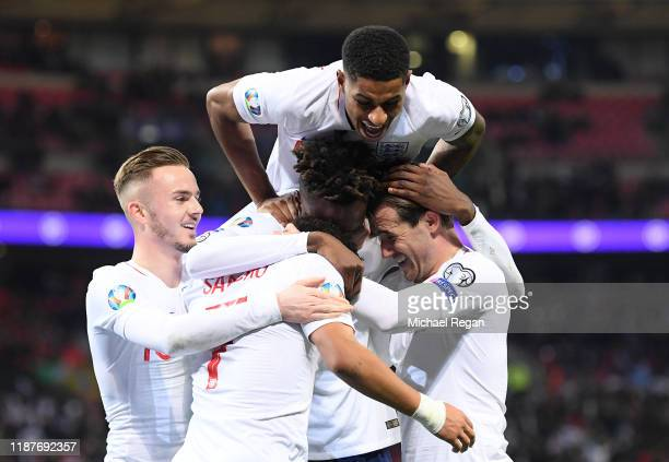 Tammy Abraham of England celebrates after scoring his sides seventh goal with team mates during the UEFA Euro 2020 qualifier between England and...