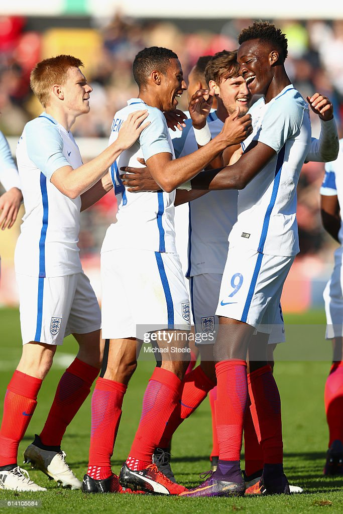 Tammy Abraham (R) of England celebrates his first goal with Isaac Hayden (C) and Duncan Watmore (L) during the UEFA European U21 Championship Group 9 match between England and Bosnia Herzegovina at Banks' Stadium on October 11, 2016 in Walsall, England.