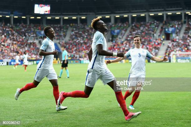Tammy Abraham of England celebrates scoring his sides second goal with Demarai Gray of England and Ben Chilwell of England during the UEFA European...