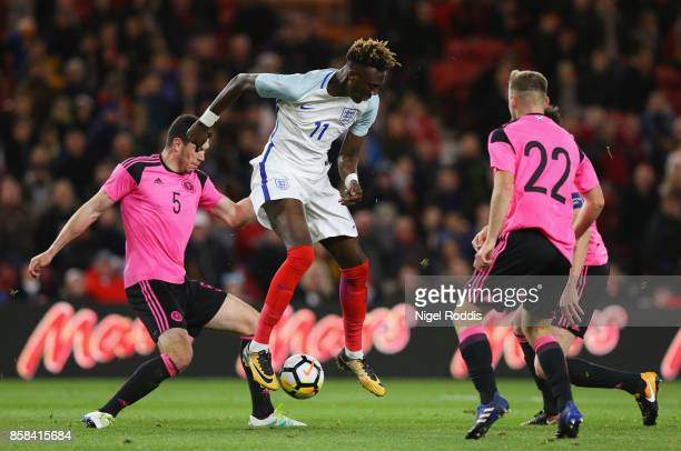Tammy Abraham of England is watched by Scott McKenna and Allan Campbell of Scotland during the UEFA European Under 21 Championship Group 4 Qualifier...
