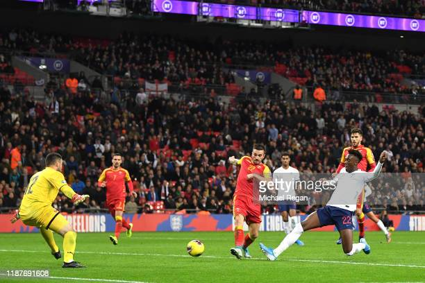 Tammy Abraham of England scores his sides seventh goal during the UEFA Euro 2020 qualifier between England and Montenegro at Wembley Stadium on...