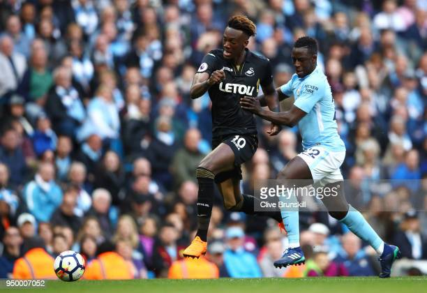 Tammy Abraham of Swansea City and Benjamin Mendy of Manchester City battle for the ball during the Premier League match between Manchester City and...