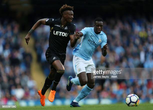 Tammy Abraham of Swansea City and Benjamin Mendy of Manchester City during the Premier League match between Manchester City and Swansea City at...