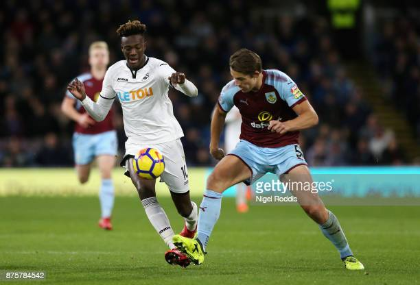 Tammy Abraham of Swansea City and James Tarkowski of Burnley compete for the ball during the Premier League match between Burnley and Swansea City at...