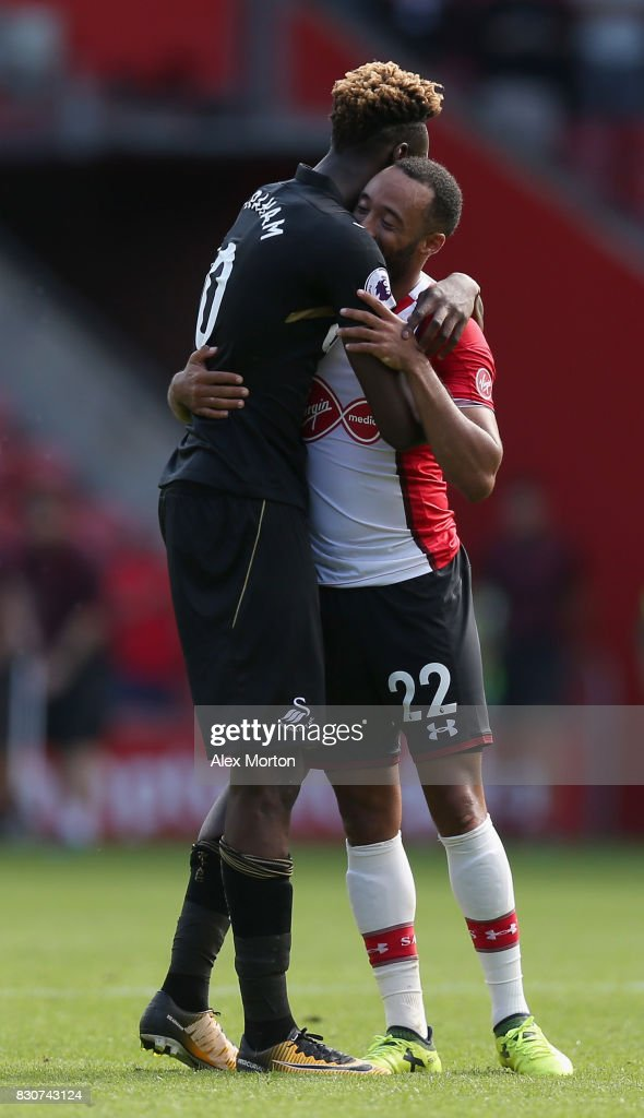 Tammy Abraham of Swansea City and Nathan Redmond of Southampton embrace after the Premier League match between Southampton and Swansea City at St Mary's Stadium on August 12, 2017 in Southampton, England.