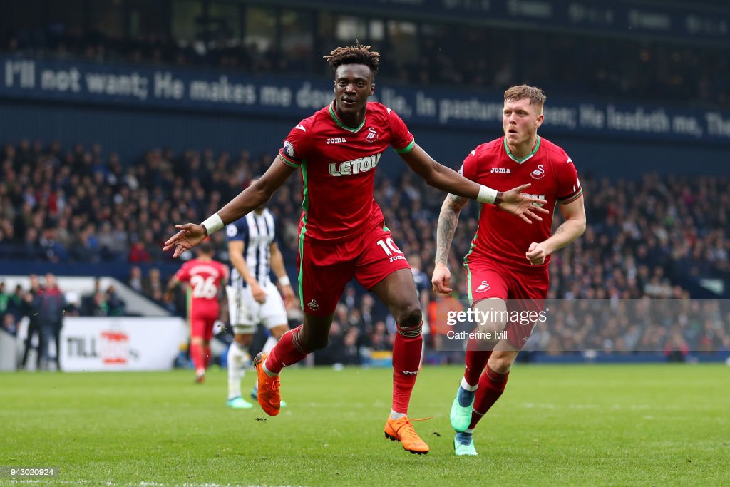 Tammy Abraham of Swansea City celebrates after scoring his sides first goal during the Premier League match between West Bromwich Albion and Swansea City at The Hawthorns on April 7, 2018 in West Bromwich, England.