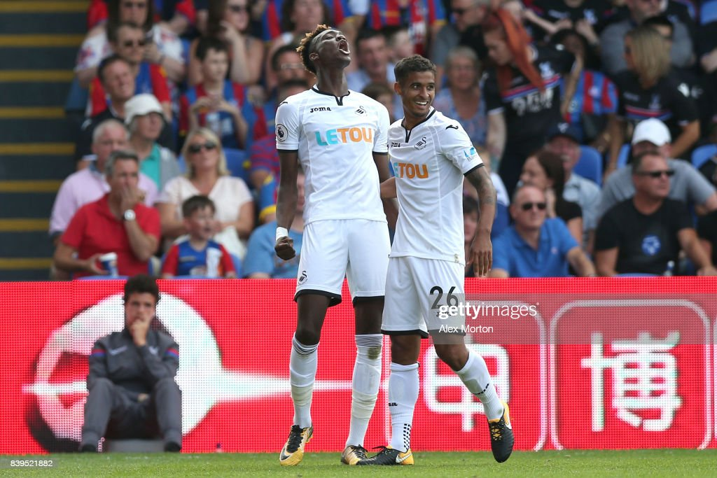 Tammy Abraham of Swansea City celebrates scoring his sides first goal with Kyle Naughton of Swansea City during the Premier League match between Crystal Palace and Swansea City at Selhurst Park on August 26, 2017 in London, England.