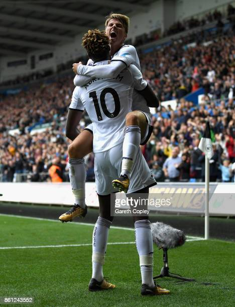 Tammy Abraham of Swansea City celebrates scoring his sides first goal with Tom Carroll of Swansea City during the Premier League match between...