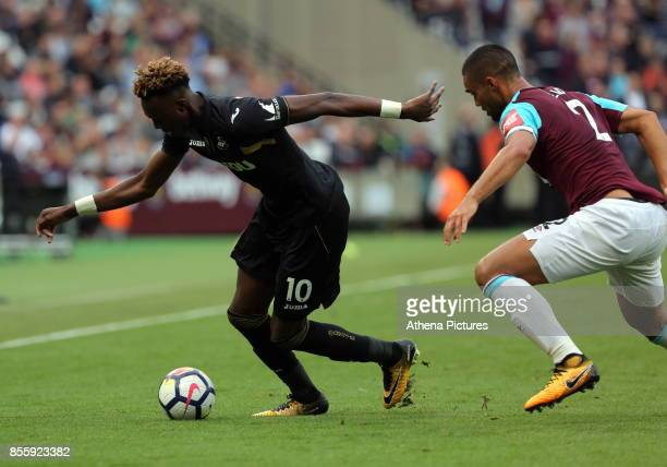 Tammy Abraham of Swansea City followed by Winston Reid of West Ham during the Premier League match between West Ham United v Swansea City at the...