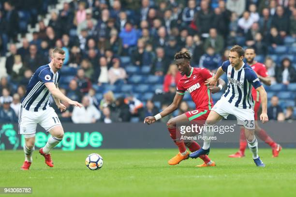 Tammy Abraham of Swansea City is challenged by Craig Dawson of West Bromwich Albion during the Premier League match between Swansea City and West...