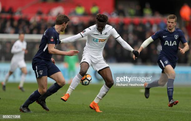 Tammy Abraham of Swansea City is challenged by Jan Vertonghen of Tottenham Hotspur during The Emirates FA Cup Quarter Final match between Swansea...