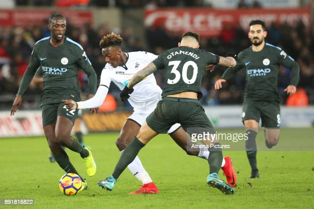 Tammy Abraham of Swansea City is challenged by Nicolas Otamendi of Manchester City during the Premier League match between Swansea City and...