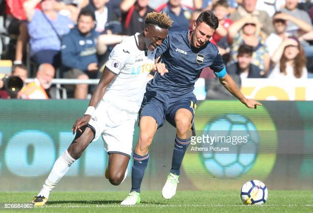 Tammy Abraham of Swansea City is challenged by Vasco Regini of Sampdoria during the preseason friendly match between Swansea City and Sampdoria at...