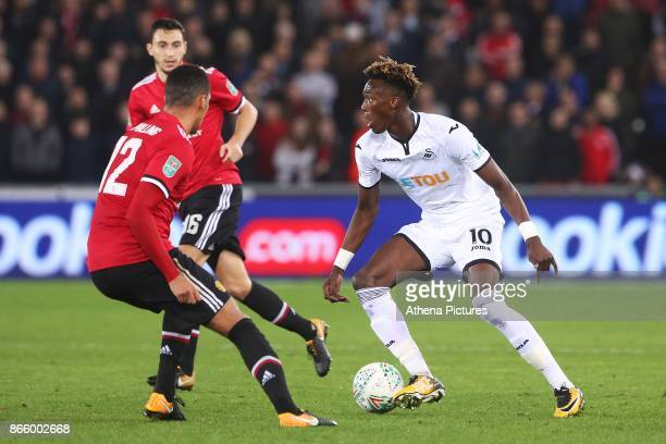 Tammy Abraham of Swansea City is marked by Chris Smalling of Manchester United during the Carabao Cup Fourth Round match between Swansea City and...