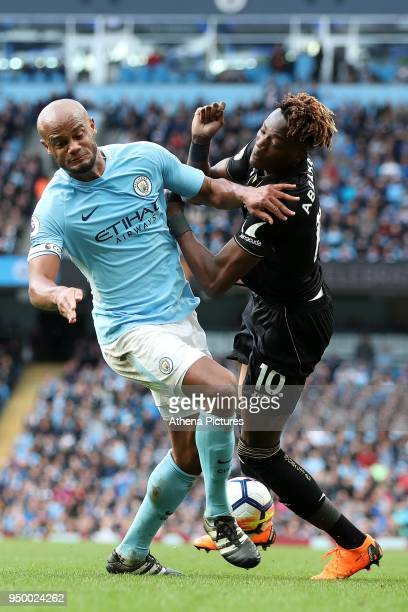 Tammy Abraham of Swansea City is tackled by Vincent Kompany of Manchester City during the Premier League match between Manchester City and Swansea...