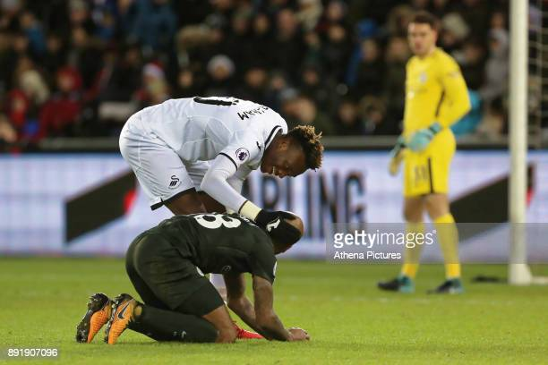 Tammy Abraham of Swansea City makes sure that Fabian Delph of Manchester City is ok after a hard challenge during the Premier League match between...