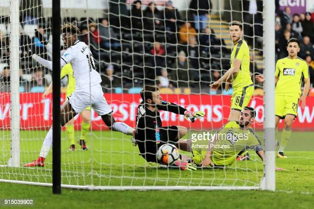Tammy Abraham of Swansea City scores his first goal against Adam Collin of Notts County during The Emirates FA Cup match between Swansea City and...