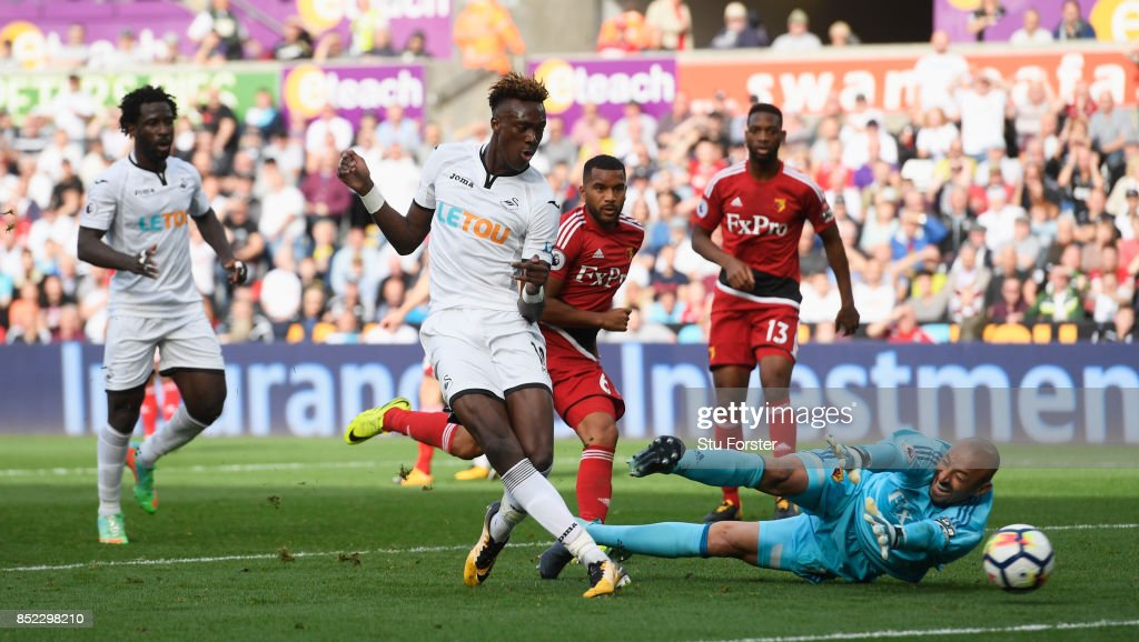 Tammy Abraham of Swansea City scores his side's first goal past Heurelho Gomes of Watford during the Premier League match between Swansea City and Watford at Liberty Stadium on September 23, 2017 in Swansea, Wales.