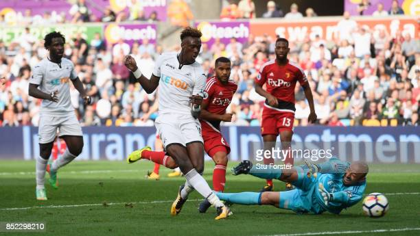 Tammy Abraham of Swansea City scores his side's first goal past Heurelho Gomes of Watford during the Premier League match between Swansea City and...