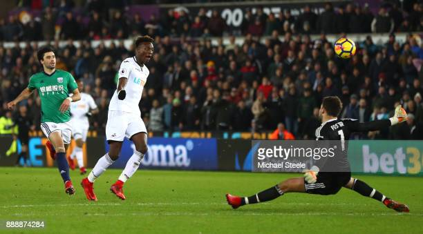Tammy Abraham of Swansea City shoots during the Premier League match between Swansea City and West Bromwich Albion at Liberty Stadium on December 9...