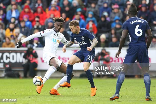 Tammy Abraham of Swansea is challenged by Kieran Trippier of Tottenham Hotspur during the Fly Emirates FA Cup Quarter Final match between Swansea...