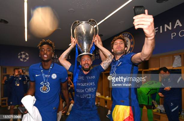 Tammy Abraham, Olivier Giroud and Marcos Alonso of Chelsea celebrate in the dressing room following the UEFA Champions League Final between...